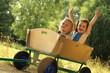 2 Cute little girls in a cart