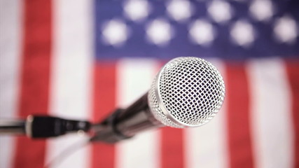 Vertical, American flag and microphone, dolly shot