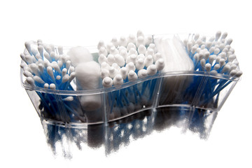 Cotton sticks and swabs in plastic container isolated on white