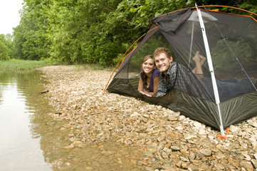 Couple camping in a tent