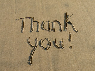 Thank You message written in sand