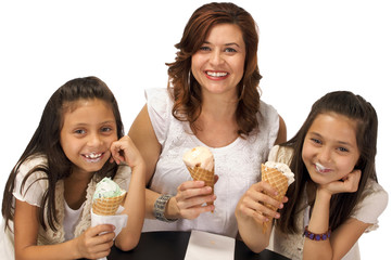 Young Girls enjoying Ice Cream with Mom