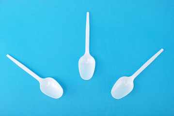 White disposable dishes, spoon