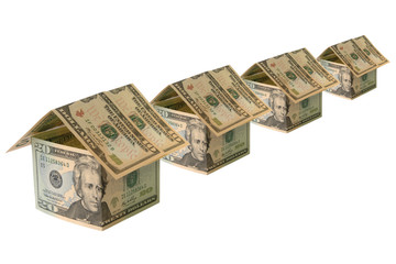 A row of houses made of US Dollar banknotes