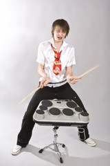 The drummer having fun playing his drum kit