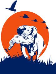 Cocker spaniel gun dog retrieving pheasant