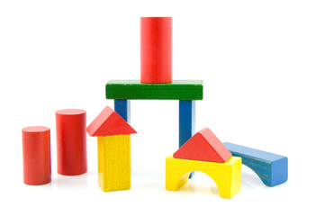 colored wooden building blocks on white background