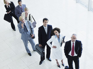 Lineup of aggravated male and female office workers