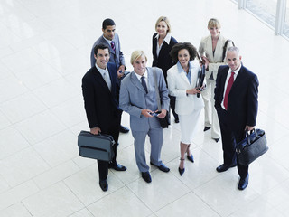 Male and female office workers posing for group portrait