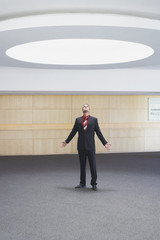 Businessman looking up at ceiling light