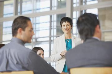 Businesswoman facilitating group meeting