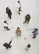 Aerial View of businesswoman standing in circle with businesspeople pointing