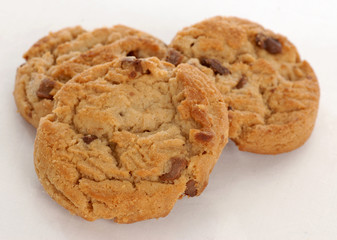 three peanut butter chocolate chunk cookies