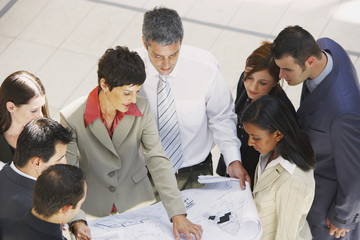 Group of businesspeople with blueprint