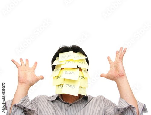 Man with face covered with todo notes, hands raised up
