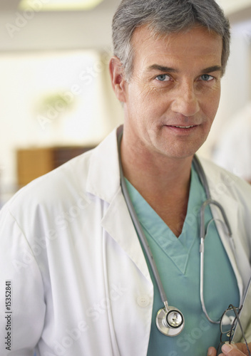 Male doctor with clipboard and stethoscope in hospital