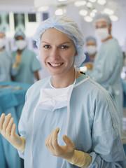 Woman in scrubs in operating room