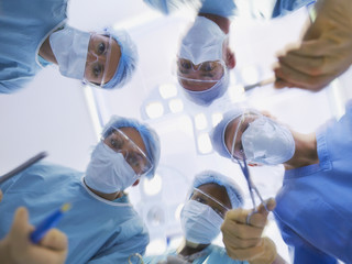 Low level view of surgical team operating