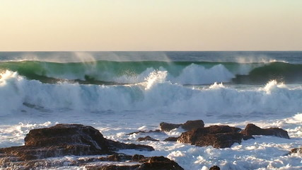 Big waves against rock in the beach