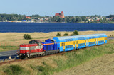 Passenger train hauled by the two locomotives against baltic sea poster