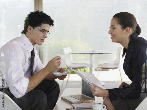 Businessman and businesswoman socializing in a coffee shop