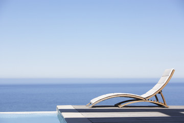 Folding chair on infinity pool deck