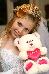 Bride with bear toy