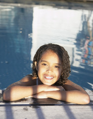 Girl in pool smiling