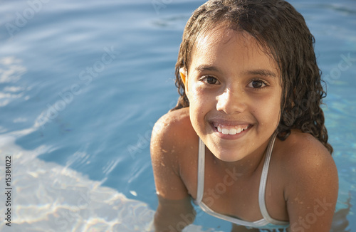 Girl in pool smiling