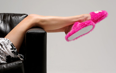 Girl wearing pink slippers realaxes