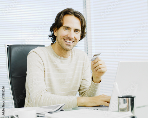 Businessman with credit card and computer