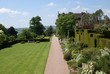 Path. hedges. topiary. seat. garden view. garden art