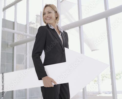 Businesswoman with blank sign arrow