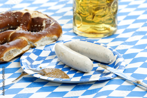 Close-up of beer stein, pretzel, weisswurst at oktoberfest
