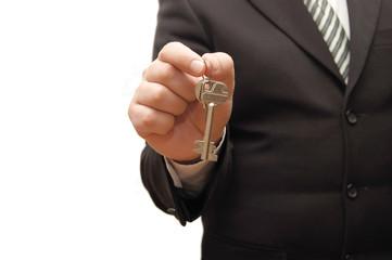 Businessman hand, holding key