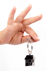 hand with chrome house key isolated handing over