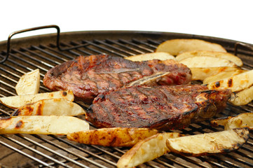 Grilled steaks and potatoes
