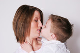 Mother and son rubbing noses poster
