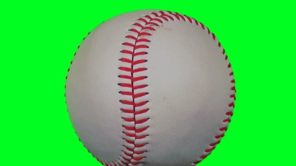 Baseball isolated against green screen rotates