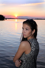 The beautiful girl on the sunset