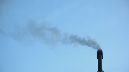 Smoke coming out from a black chimney