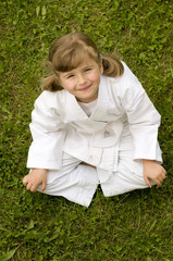 Little girl exercising in garden