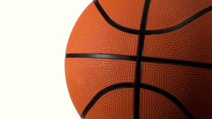 Basketball rotates against white with copy space - HD
