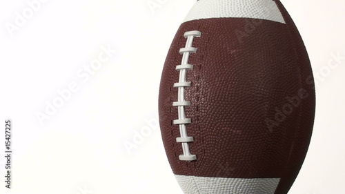 Football spins against white with copy space- HD