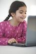 Little girl behind a laptop