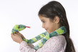 Little girl is talking to her toy snake