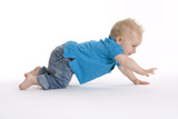 Toddler boy is crawling in a hurry poster