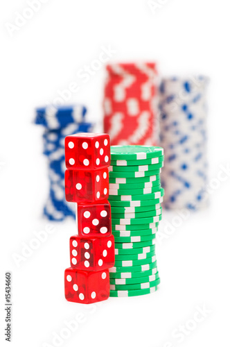 Stack of chips and dice isolated on the white background