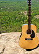 Guitar In Nature Atop Of Mountain