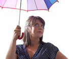 Confident woman with umbrella, isolated on a white background.